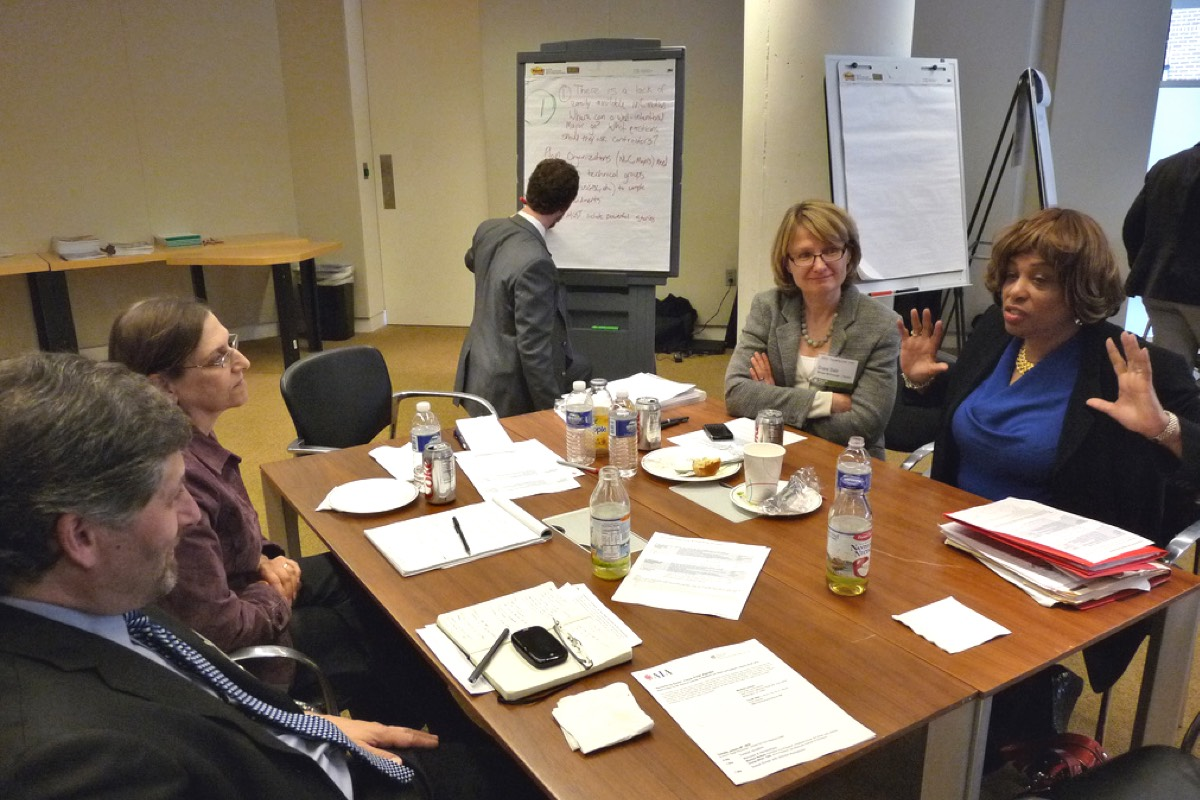 Practitioner's Forum discussion around table