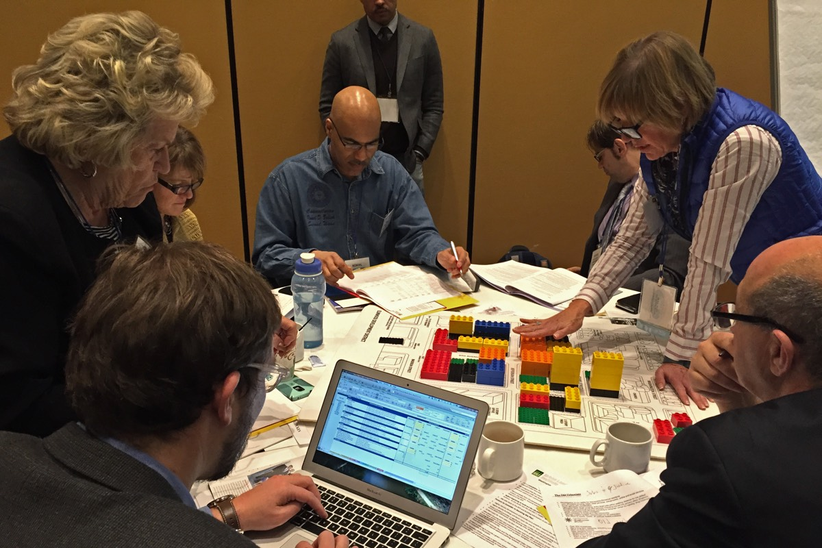 Workshop group working on city diagram around table