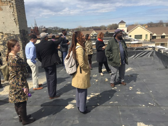 NLC's Equitable Economic Development Fellowship team overlooks Milwaukee from a rooftop