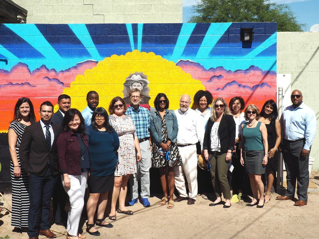 NLC's 2018 Equitable Economic Development felloship team standing outside mural in Phoenix, Arizona